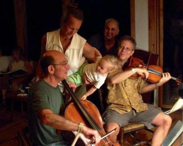 In the Berkshires in summer 2005, Jules Eskin (left) and Mark Ludwig played for Ludwig's wife and daughter, Kate Gascoigne and Sarah, and a friend, Howard Schaevitz (rear).