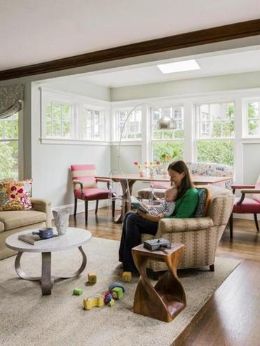 Caroline McCabe Springer and her young son read together in the living room, where reupholstered and new pieces blend beautifully.