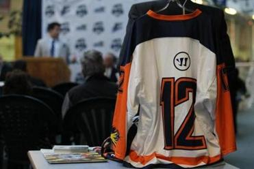 A jersey of the Boston Rockhoppers professional lacrosse team hangs above a table at the New England Sports Center, where the team will play its home games