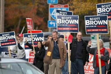 Clad in his signature barn coat, Senator Scott Brown stood along the road in Middleborough.