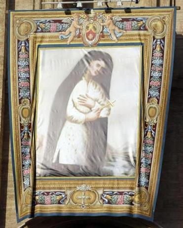 A tapestry of Kateri Tekakwitha, the first American Indian to achieve sainthood, was displayed in St. Peter's Basilica.