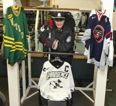 Stephanie O'Sullivan at the District 11 station workout room; she's also worn the uniform of the Matignon, Providence, and US hockey teams.