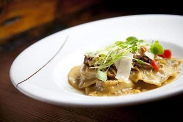 Pork-filled ravioli with bacon, Chinese celery, and Parmesan cheese.