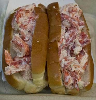 Specialties include twin lobster rolls (pictured), lobster bisque, and boiled lobster, as well as chowder, calimari, and fried seafood.