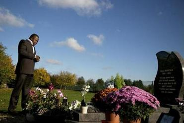 Yodi Zikianda cried at the grave of his wife, a French citizen who died at age 29 while in US custody.