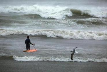 A lone surfer braved the waves in Lynn as Hurricane Sandy arrived in Massachusetts.