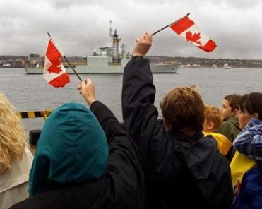 Family members wave as the HMCS Iroquois heads out of Halifax to the Persian Gulf.