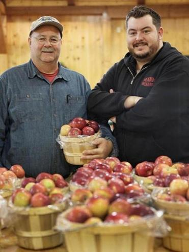 Bill (left) and Matt Fitzgerald at Mann Orchards in Methuen, where Bill's mother's recipe is still used for their thousands of apple pies.