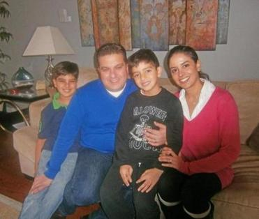 From left: Hussein, Omar, Jad, and Zeina Salem posed for a picture in their Canton home.