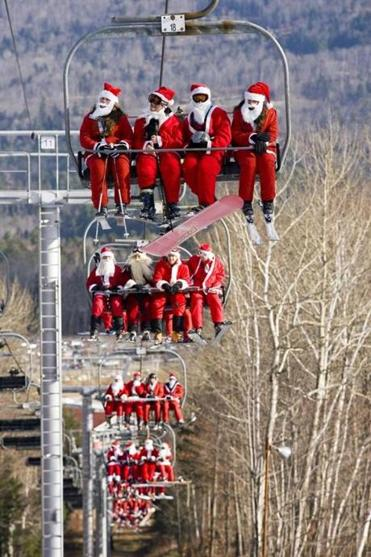 On Santa Sunday at Sunday River Resort in Maine, Santas ski for free.