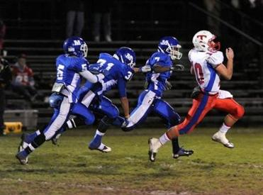 Tewksbury's #10 Johnny Aylward (right) ran major yardage despite a gaggle of Methuen defenders on his tail.
