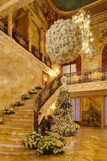 In Newport, the foyer at Marble House; Jim Donahue decorates Mrs. Vanderbilt's bedroom at The Breakers.