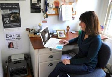 Resnick works in her office with Aron's picture close by.