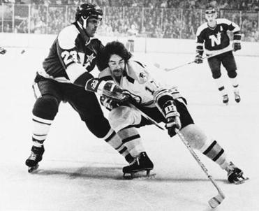 Derek Sanderson (17) and Minnesota North Stars' Lou Nanne (23) battled for the puck in a game on Thursday, Dec. 14, 1973 at the Boston Garden. Boston won the game 4-2.