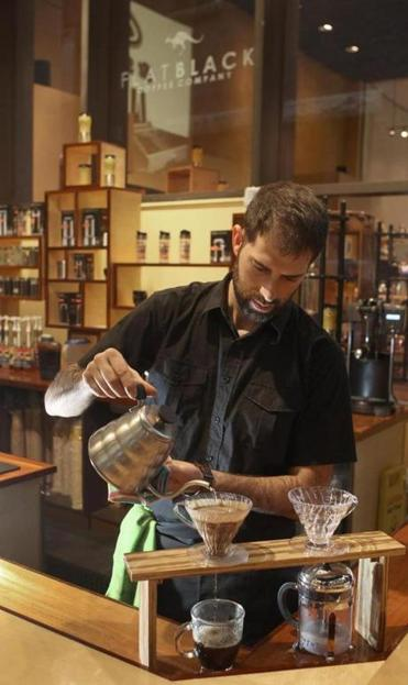 Barista Evan Collier at Flat Black on Franklin Street.
