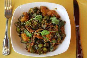 Bhindi aloo and naan are among the traditional Indian dishes.
