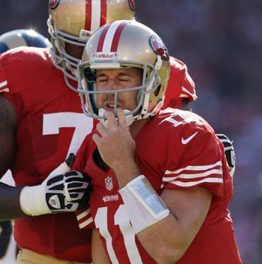49ers QB Alex Smith stayed in Sunday's game for several plays after what appeared to be a head-rattling hit.