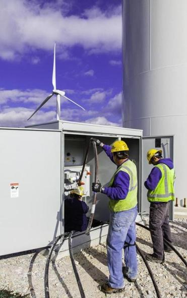 Workers made electrical connections at a transformer at one of the Hoosac's 19 wind turbines.
