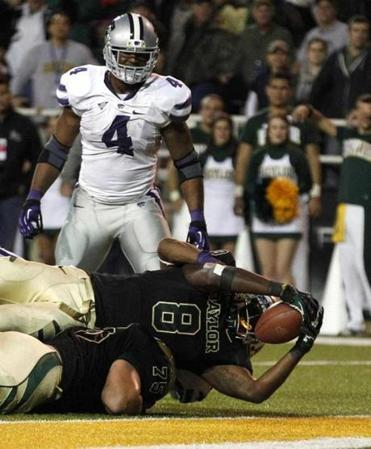 Baylor's Glasco Martin (8), with a big lift from teammate Troy Baker, breaks the plane for a first-half touchdown.