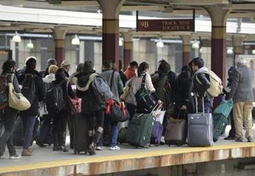 Travelers waited at South Station for a train to Washington, D.C., on Wednesday.