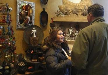 Tricia and Kevin Collins, of Hanover, browsed at Nomad in Cambridge as part of Small Business Saturday.