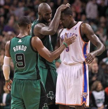 Kevin Garnett and Rajon Rondo got together with former teammate Kendrick Perkins, now a center with the Oklahoma City Thunder, at the end of a game at TD Garden on Dec. 23, 2012.