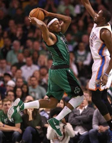 Paul Pierce is caught in a dilemma: shoot over the Thunder's Kevin Durant or find an open teammate.