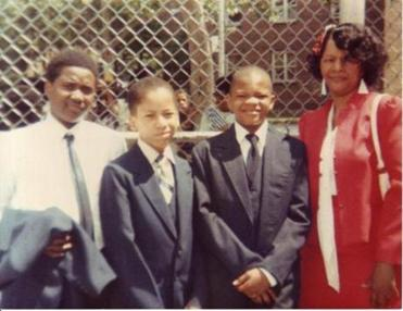 Kevin Richardson (second from right) with his mother, Gracie Cuffee, and classmates Sheron and Yero Bailey.
