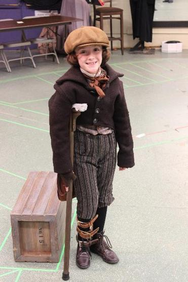 "Sophia Wulsin, 8, portrays Tiny Tim in the North Shore Music Theatre's ""A Christmas Carol."""