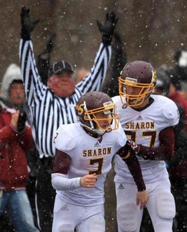 It's official: Sean Asnes (2) records Sharon's first touchdown and earns a well-done pat from teammate Adam Banks.