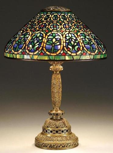 "Top seller at James D. Julia's Lamp & Glass Auction was this Tiffany Venetian table lamp (left) that brought $103,500 against a $60,000-$80,000 estimate. Headlining Sotheby's Important 20th Century Design Auction is this rare circa 1915 Tiffany Magnolia floor lamp (right), expected to bring $650,000-$800,000. The expected top seller at Skinner's 20th Century Design Auction is this Tiffany Poppy table lamp (left below). The estimate is $30,000-$40,000. The piano on which Sam plays ""As Time Goes By"" in the Paris flashback scene in the 1942 film classic ""Casablanca"" will be sold Friday by Sotheby's with an $800,000-$1.2 million estimate. This Mount Washington Burmese monkey vase led the vases at Julia's sale."
