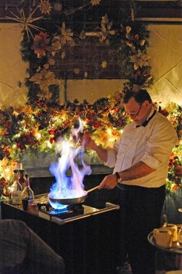Waiter Alan Cassell prepares Bananas Foster tableside at the 1785 Inn & Restaurant in North Conway, N.H.