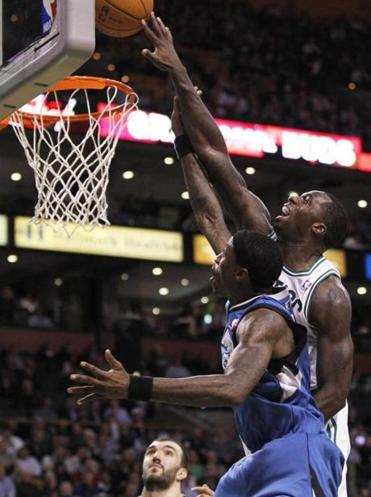 Brandon Bass, who scored 12 points, reached another level to block Josh Howard's shot in the third quarter.