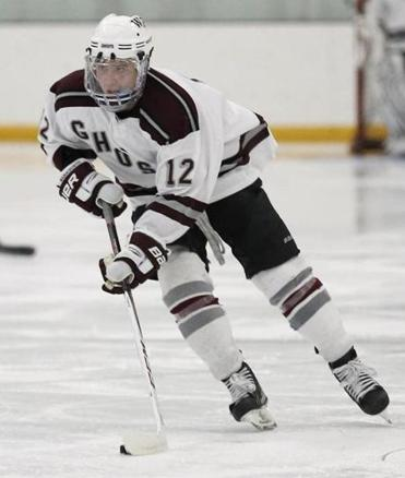 Westford Academy's Cam MacDonald (12) skated the puck up the ice during a scrimmage against Lincoln-Sudbury in Tyngsboro