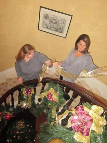 Erika Cherko-Soykan and Gigi Rizzuto of the Winslow Homer Holiday House Committee prepare the historic William Flagg Homer House for this weekend's open house.