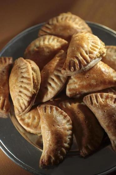 Goat cheese and caramelized onion empanadas.