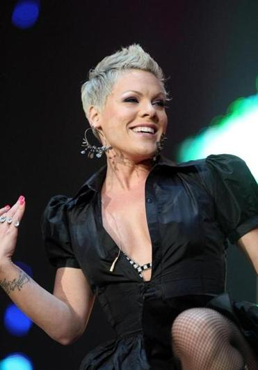 Pink performs on stage during the opening night of the UK Funhouse Summer Carnival stadium tour.
