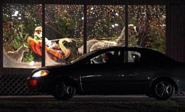 "People stay in their cars as they drive through the ""Millis Wonderland"" on Causeway Street and look at the displays."