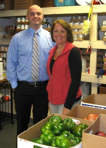 Joe Babcock, president of Referral Connection, and Debbie Jones, manager of client services for the Wakefield Interfaith Food Pantry, are teaming up for the Food for Friends drive.