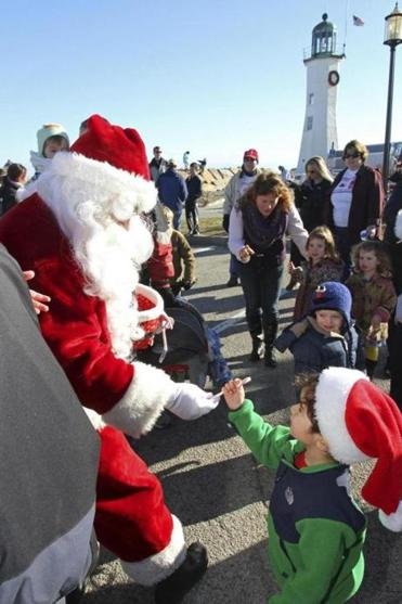 Santa greets the crowd at the Scituate Lighthouse Dec. 15, 2012. (Brian Tague photo)