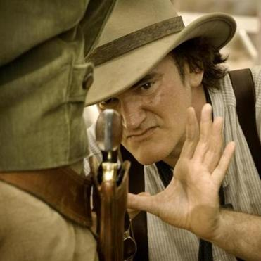 """A tale of an ex-black slave who goes out to save his woman in the worst plantation imaginable, that deserves to be presented as high drama, as a big opera,'' says Quentin Tarantino, pictured on the set of ""Django Unchained."""