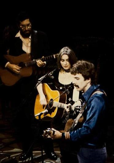 From left: David Bromberg, Emmylou Harris, and Tom Rush performing at Symphony Hall in 1983.