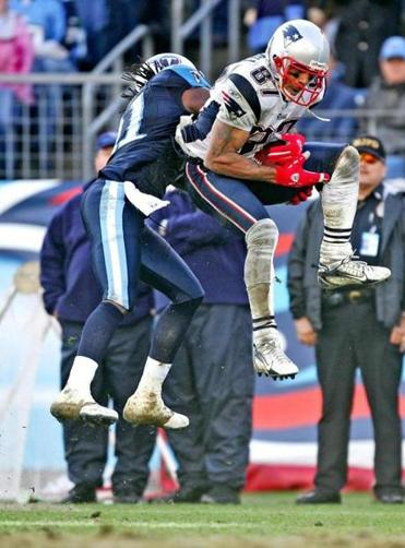 Reche Caldwell leaped over the Titans' Reynaldo Hill en route to his 62-yard touchdown reception.