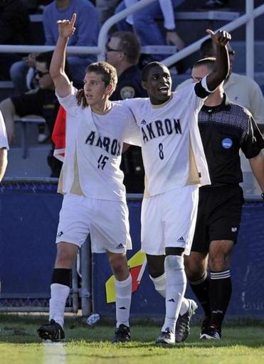 Scott Caldwell (15) joins former Akron teammate Kofi Sarkodie (8) in MLS. Here they celebrate an NCAA championship in 2010.