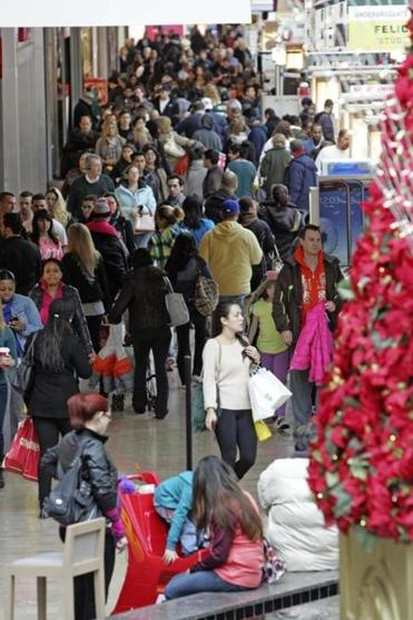 Last-minute Christmas shoppers crowded Willowbrook Mall on Sunday in Wayne, N.J. But Americans have a lot on their minds on top job worries, retail analysts say.