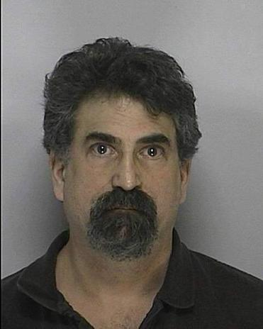 Melvin A. Ehrlich of Millis, a pediatric dentist, is facing pornography charges.