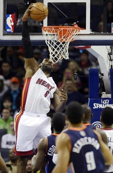 LeBron James (27 points, 12 rebounds, 8 assists) took flight as the Heat topped the Bobcats.
