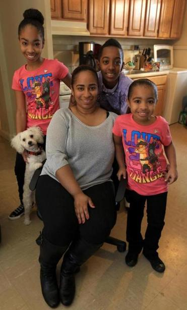 Rebecca Davila and her family live in a housing authority apartment. With her, from left, are Genesis, 11 (with their dog Woody); Luis, 13; and Priscilla, 7. Luis has asthma.