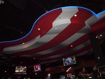 The ceiling picks up the motif of an 85-foot guitar-shaped bar at Toby Keith's I Love This Bar & Grill.