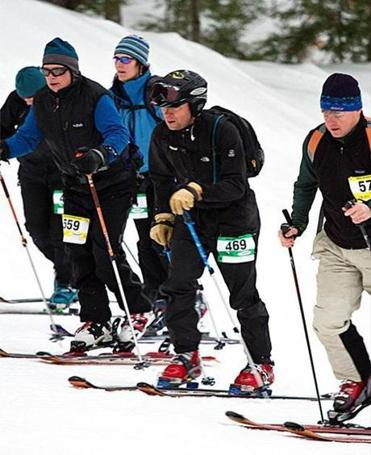 Skiers head uphill during a Winter Wild race at New Hampshire's Mount Sunapee. Resort policies vary on uphillers.